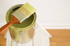 Paintbrush and can on ladder. Royalty Free Stock Photo