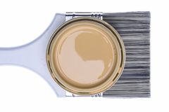 Paintbrush and Can Lid with Creme Color Paint Isolated on White Background Stock Photography