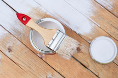 Paintbrush with can on wooden table Stock Images