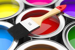 Paintbrush on cans with color prints Royalty Free Stock Photography