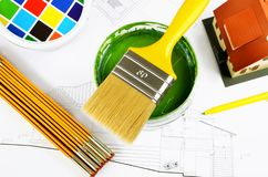 Paintbrush on cans with color prints,house model, helmet with house project, top view stock photos
