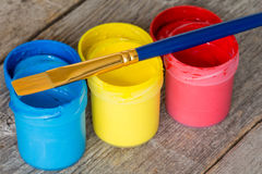 Paintbrush and cans with paint Stock Images