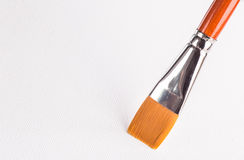 Paintbrush on a canvas Royalty Free Stock Photos