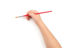 Paintbrush in child hand Stock Photo