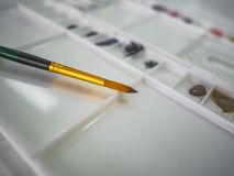 Paintbrush with color tray. On the table stock images