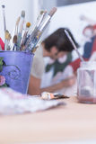 Paintbrush container - painting session Stock Photography