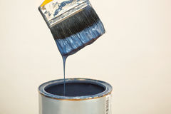 Paintbrush after dipping it into paint bucket Stock Image