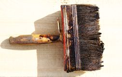 Paintbrush. Аfter a day of work the painter put brush on the lumber Stock Images