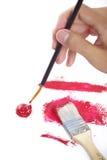 Paintbrush in hand. Isolated on white background Royalty Free Stock Image