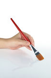 Paintbrush in hand. For background Royalty Free Stock Photo