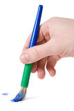 Paintbrush in hand Stock Images