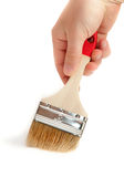 Paintbrush in hand Stock Photography