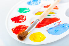 Paintbrush lies on the palette Stock Images