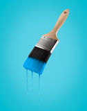 Paintbrush loaded with blue sky color dripping off the bristles. Paintbrush loaded with blue sky color dripping off the bristles, on blue sky background Stock Images