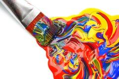 Paintbrush and mixed acrylic paint royalty free stock photo