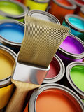 Paintbrush and multicolored paint cans Stock Photography
