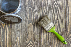 Paintbrush and open cans of lacquer paint Royalty Free Stock Photography