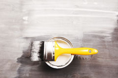 Paintbrush and a opened can Stock Photography