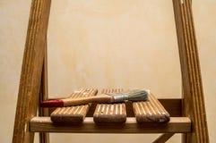 Paintbrush over ladder Stock Photo