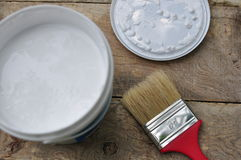 Paintbrush and pain can. On the wood backgroud Royalty Free Stock Photography