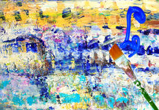 Paintbrush, paint on abstract painting. Paintbrush and squirt of blue paint on a colorful abstract painting Royalty Free Stock Photo