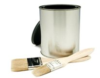 Paintbrush With A Paint Can. Close-up of paintbrush with a paint can isolated over white Royalty Free Stock Image
