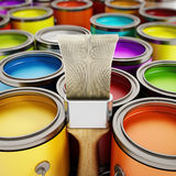 Paintbrush and paint cans. Paintbrush and multicolored paint cans Stock Photo