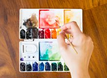 Paintbrush and paint palette Stock Photos