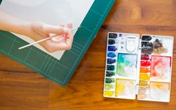 Paintbrush and paint palette Stock Photo