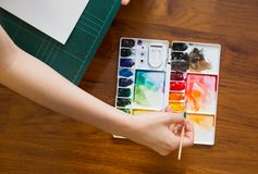 Paintbrush and paint palette Stock Photography