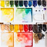 Paintbrush and paint palette Stock Images