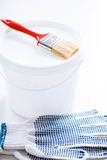 Paintbrush, paint pot and gloves Stock Images