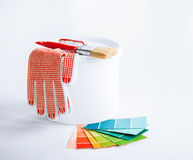 Paintbrush, paint pot, gloves and pantone samplers Stock Image