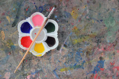 Paintbrush with paint on table paint Royalty Free Stock Photos