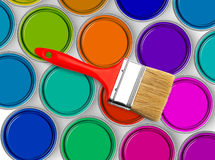 Paintbrush on paint tins Royalty Free Stock Images