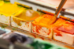 Paintbox. Paintbrush and a paintbox. orange Royalty Free Stock Image