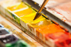 Paintbox. Paintbrush and a paintbox. yellow Royalty Free Stock Images