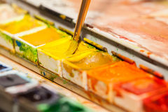 Paintbox. Paintbrush and a paintbox. yellow Royalty Free Stock Photo