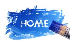 Painting home word. Paintbrush is painting sky with home word on white screen , isolated background Stock Images