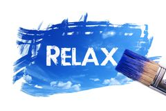 Painting relax word. Paintbrush is painting sky with relax word on white screen , isolated background stock image