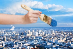 Paintbrush paints blue sky over big city Royalty Free Stock Photos
