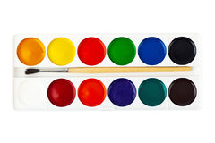 Paintbrush and paints Stock Images