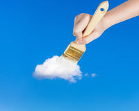 Paintbrush paints lonely white little cloud Royalty Free Stock Photography