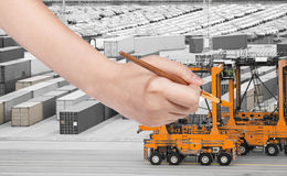 Paintbrush paints orange crane in cargo port Royalty Free Stock Images