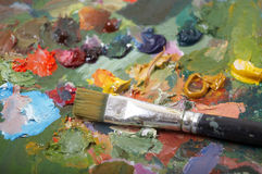 Paintbrush on palette Stock Photo
