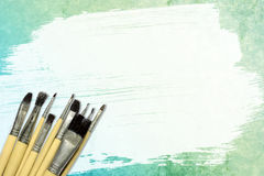 Paintbrush and paper watercolor. On white paper royalty free stock image