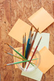 Paintbrush and post it Stock Photos