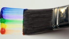 Paintbrush with a rainbow brush stroke stock video