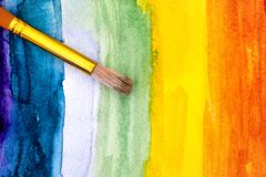 Paintbrush on rainbow watercolour hand drawing backgrounds. Royalty Free Stock Image