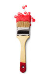 Paintbrush with red paint Royalty Free Stock Photography